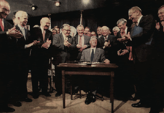 Greenspan, left, smiles and applauds