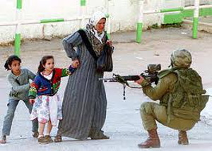 Israeli soldier aiming at Palestinian children